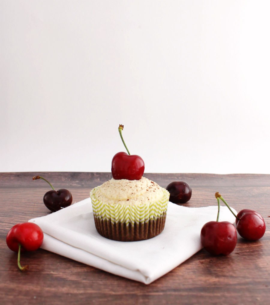 Delicious dark chocolate cupcakes with a rich cherry filling and white chocolate frosting!