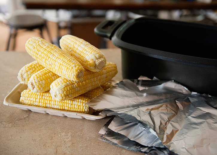 This slow cooker corn on the cob is the easiest way to cook corn. Keep your kitchen cool by cooking large amounts of corn in the slow cooker all summer long.