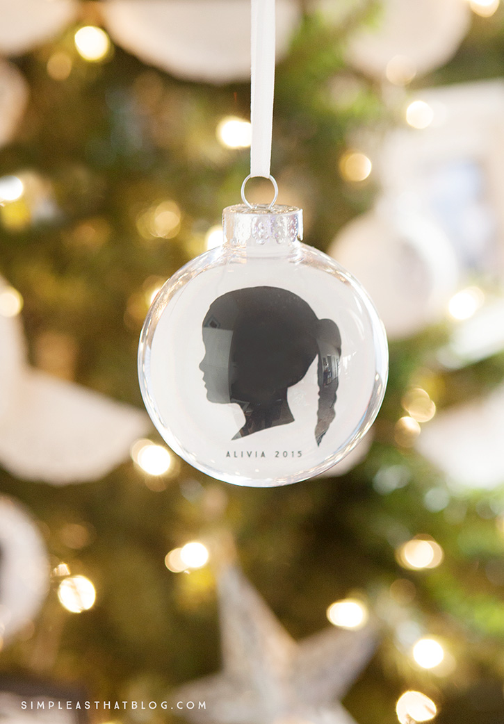 As a parent, have you ever wanted to freeze time? These simple, DIY, silhouette keepsake ornaments may not help you freeze time, but they will at least allow you to capture it—as you display your children's profiles year after year on your Christmas tree.