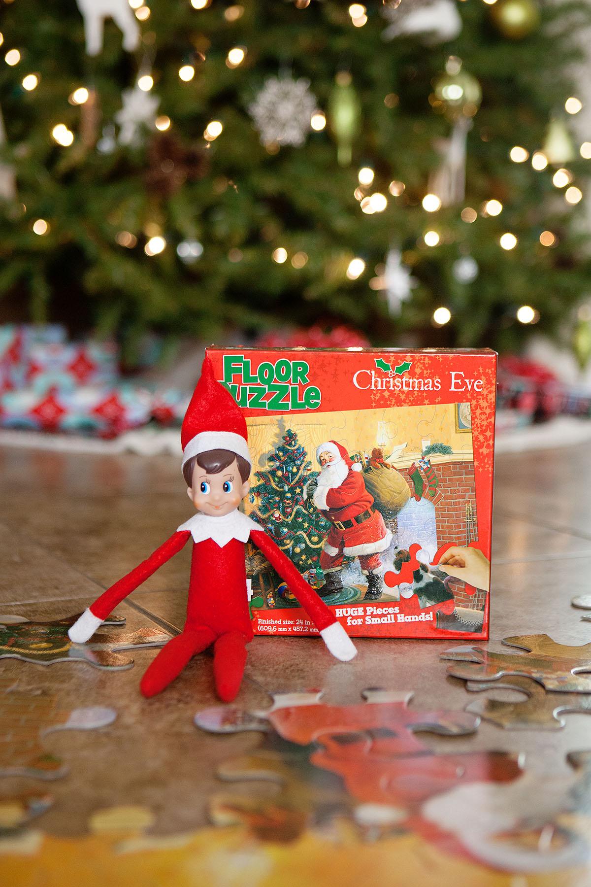 Elf attempts doing a puzzle.