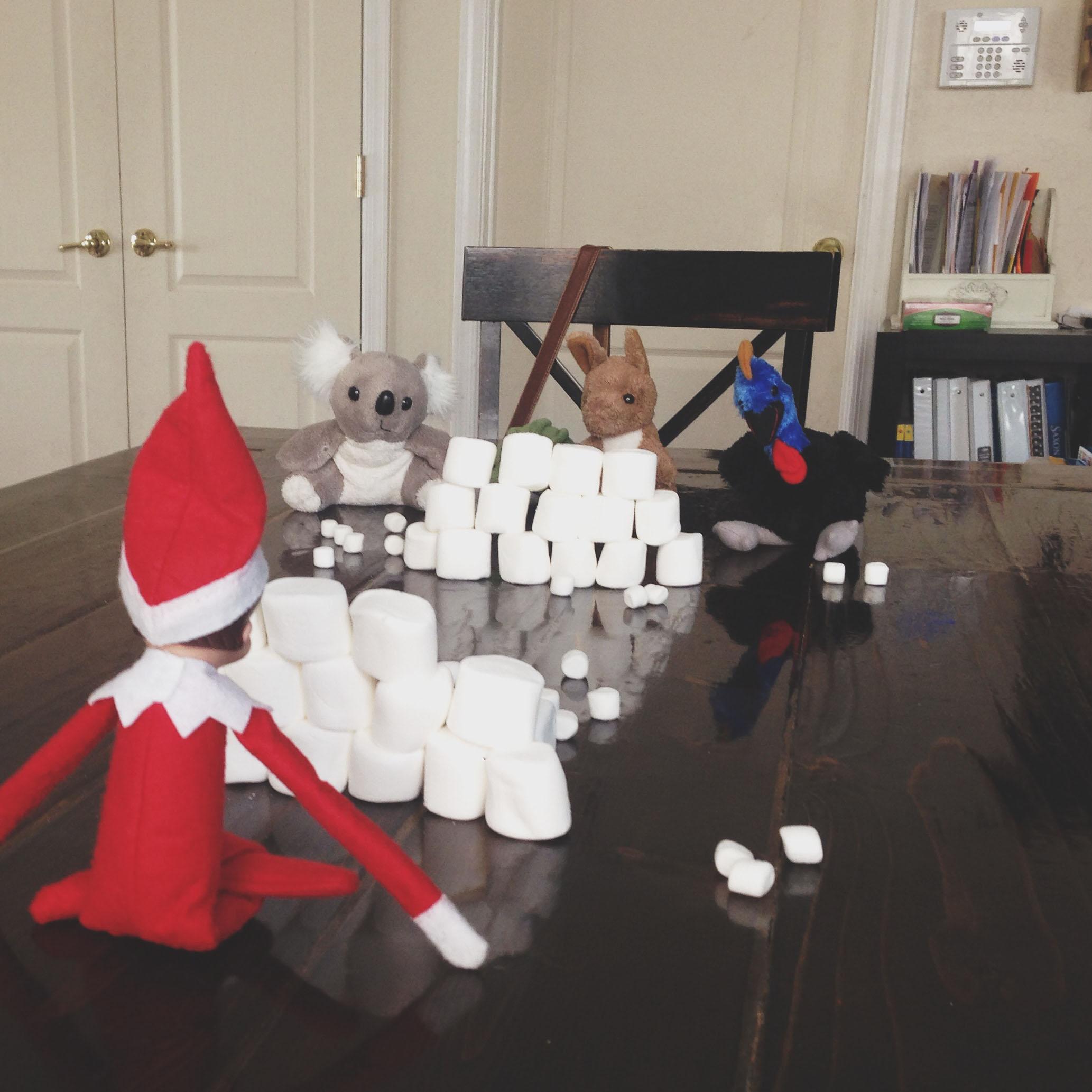 Elf having a snowball fight.