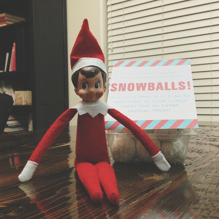 Elf delivers a special after-school snack — snowballs! (powdered donuts)