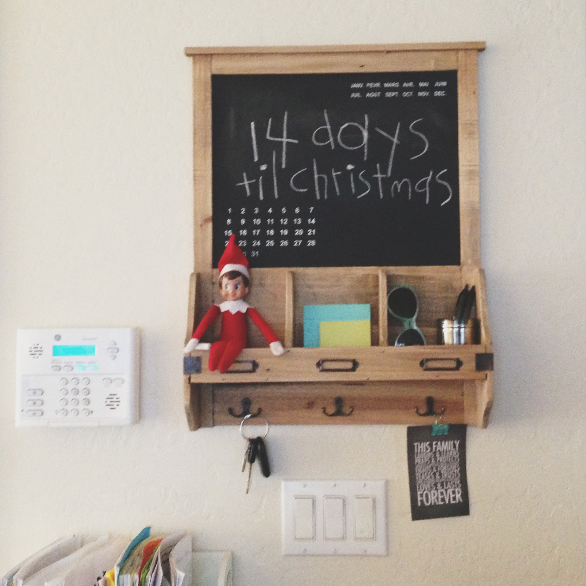 Elf counting down the days until Santa arrives.