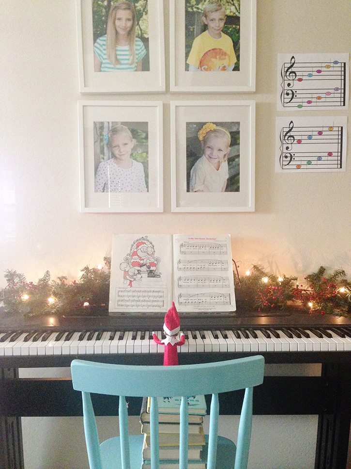 Elf plays a piece on the piano.
