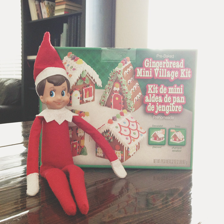 Elf brings a special delivery - a gingerbread house to make!