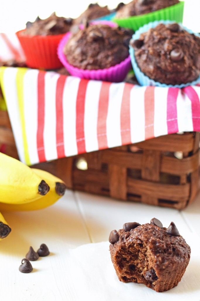 Healthy Chocolate Banana Muffins - You'd never guess these moist, chocolaty muffins are refined sugar free and full of healthy whole grains. Perfect for a healthy breakfast on the go!
