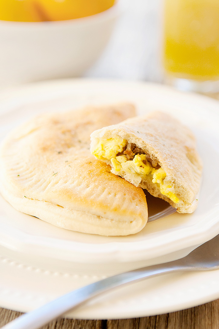 Filled with scrambled eggs, sausage and cheese, these easy breakfast calzones are a filling breakfast you can eat on the go.