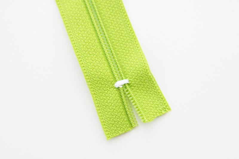 Trimming a shortened zipper