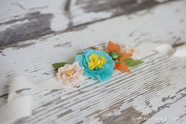 Flowers for Mother's Day always seem fitting, so this year why not give mom a bouquet that she could enjoy all year round? Using this inexpensive list of supplies, you can make some darling crepe paper flowers.