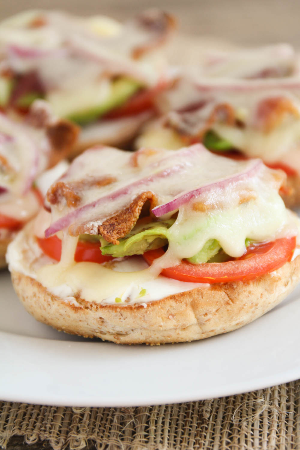Topped with avocado, bacon, red onion (and more) these open-face bacon and swiss bagels are perfect for breakfast, lunch or snacktime!