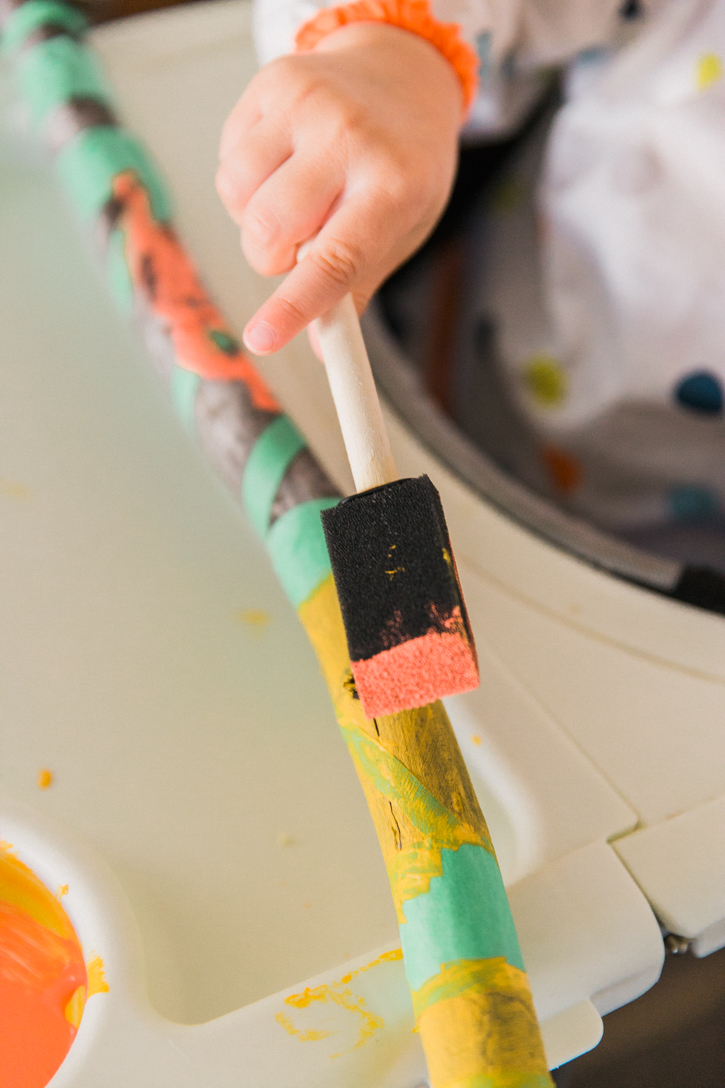 Add some color to your next nature hike with a DIY painted walking stick. This craft is so simple it would be perfect for camping or at home!