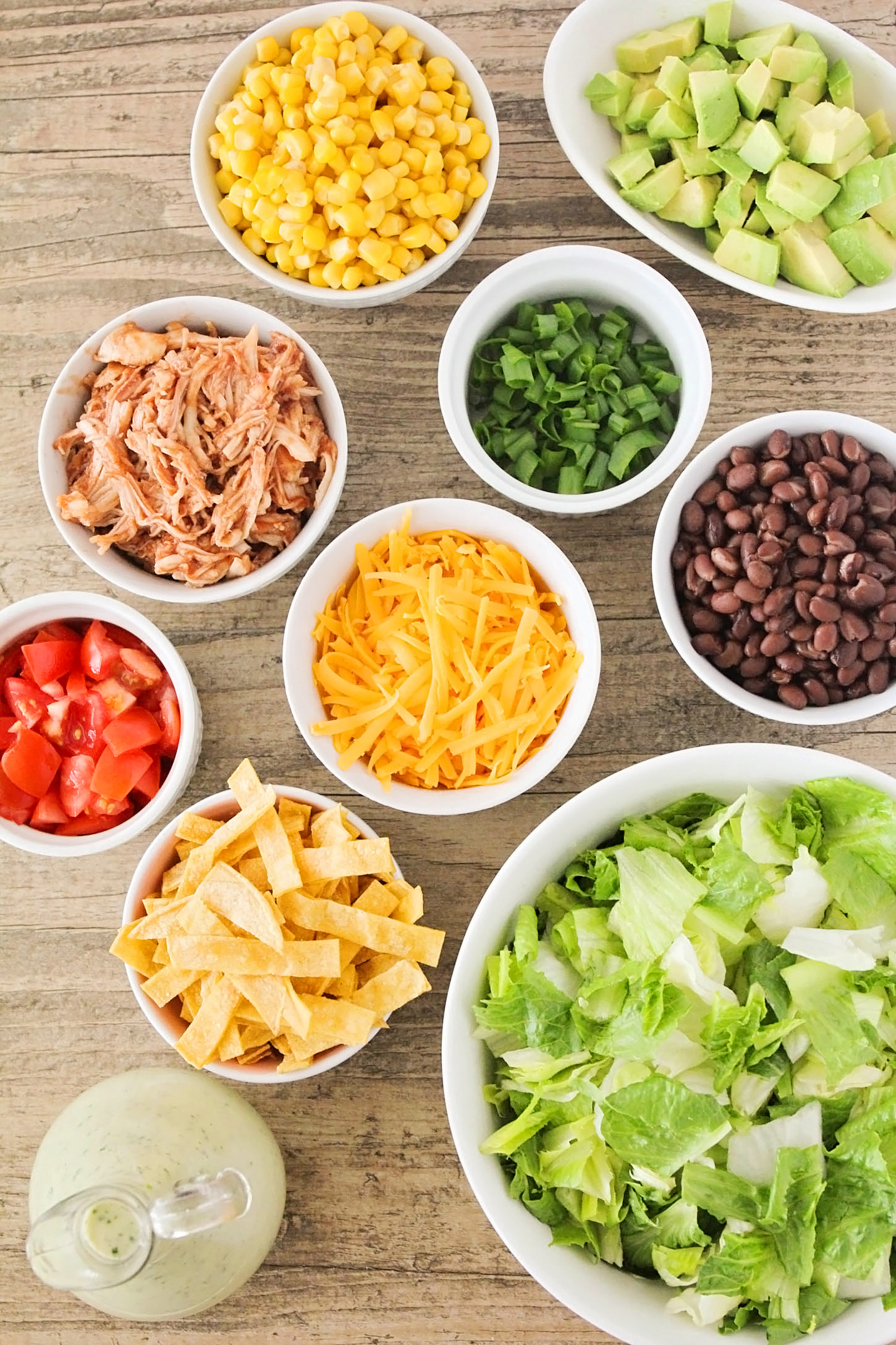 This Southwest BBQ Chicken Salad with Creamy Lime-Cilantro Dressing is a quick dinner option that's full of healthy ingredients and so packed with flavor your family will asking for it again and again!