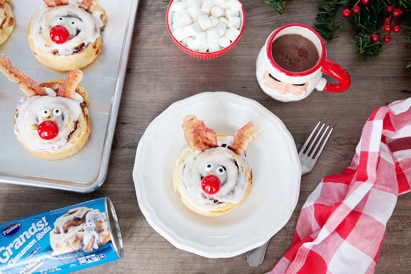 These Rudolph the Red-Nosed Reindeer Cinnamon Rolls will help make the holidays a bit more magical with minimal effort required!