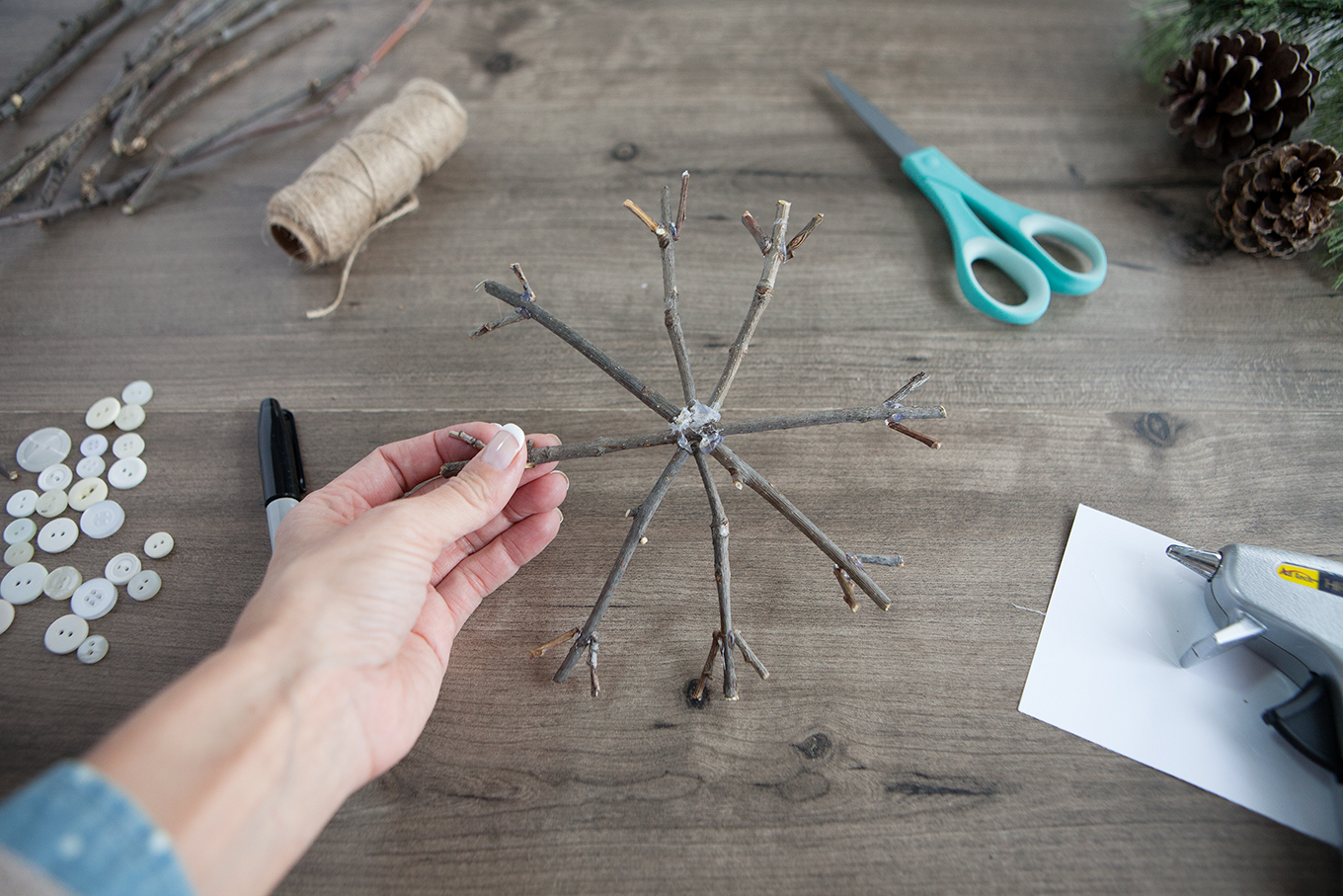 Bring a touch of nature indoors this year as you decorate your tree – learn how to make rustic twig Christmas ornaments! They're simple, insanely inexpensive and look beautiful!