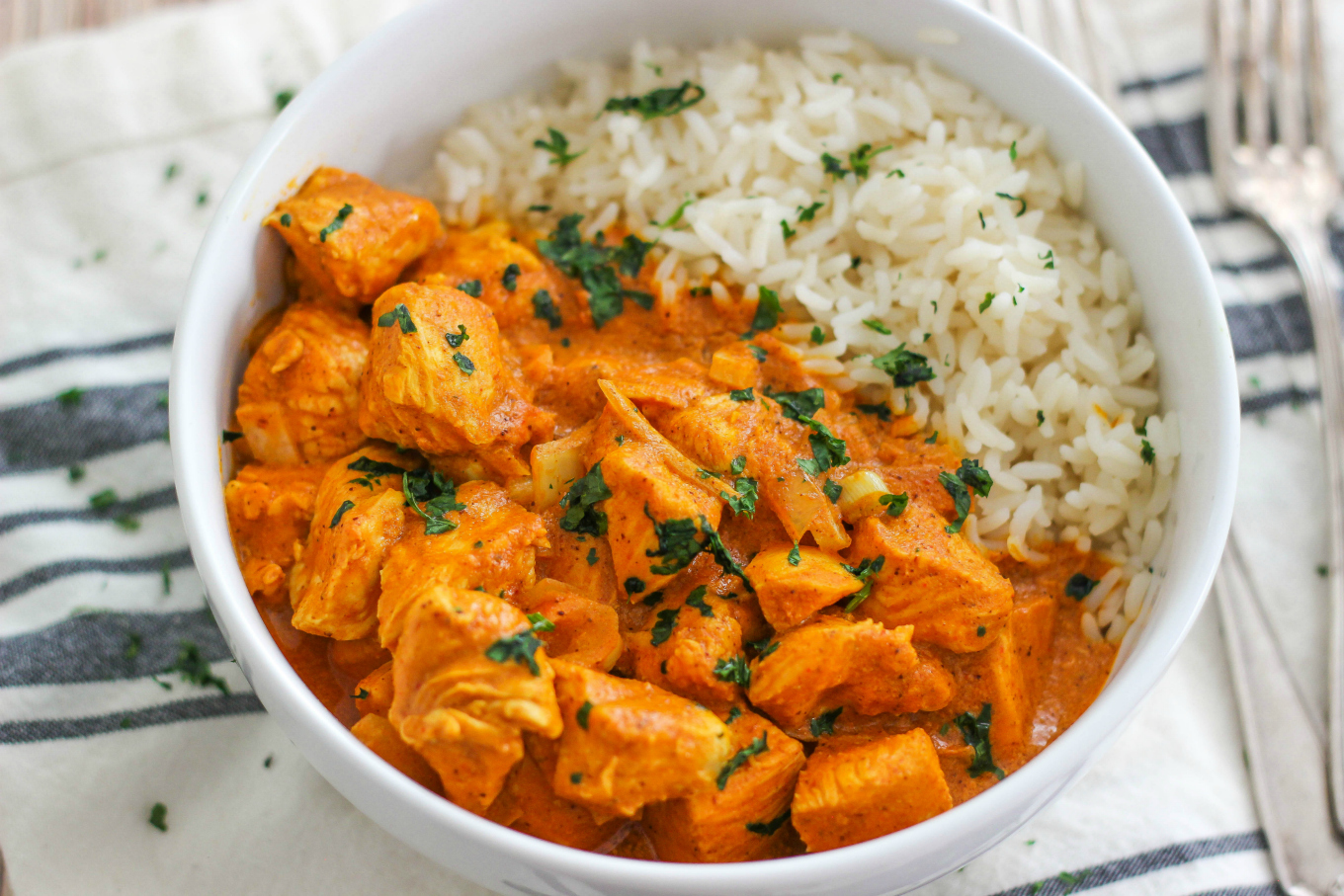 Easy Slow Cooker Butter Chicken is a flavorful Indian chicken dish cooked in a coconut curry sauce and served with rice. This is a simple weeknight meal.