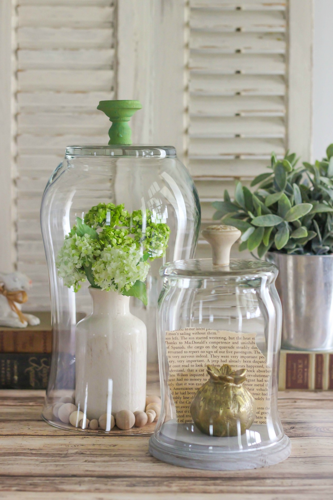 Create a DIY Glass Display Cloche with Knob with a glass vase, hardware knob, and Clear Gorilla Glue®. This is an easy, and inexpensive home decor project.