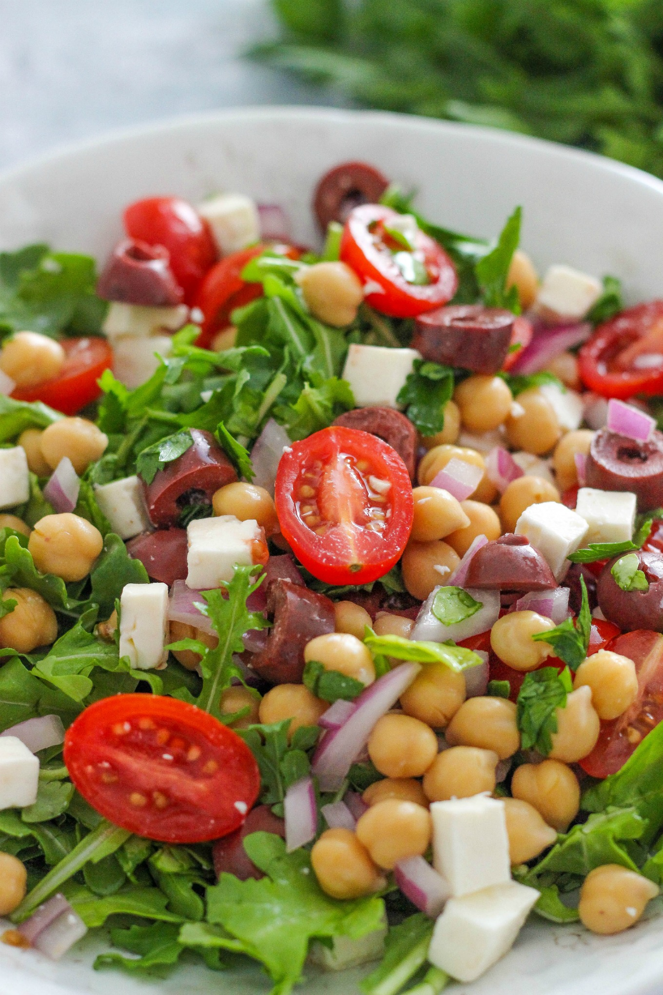 Mediterranean Chickpea and Arugula Salad is a crisp and easy to make salad full of fresh flavors. This salad is perfect for summer!