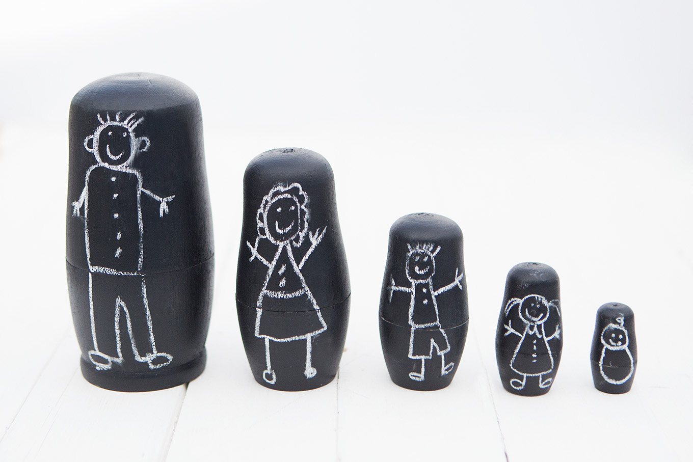 These DIY Chalkboard Matryoshka Nesting Dolls are an adorable, handmade toy your kids will love making! They can personalize the dolls again and again with nothing more than a piece of chalk.