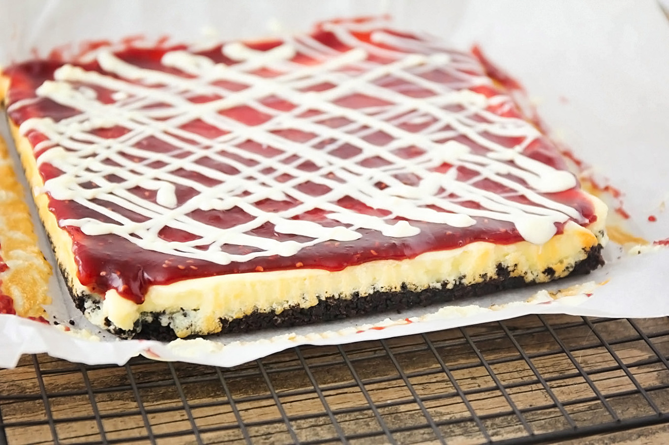 These White Chocolate Raspberry Cheesecake Bars don't just look fancy they taste fancy too! The white chocolate and raspberry flavors paired with a homemade oreo crust make them hard to resist.