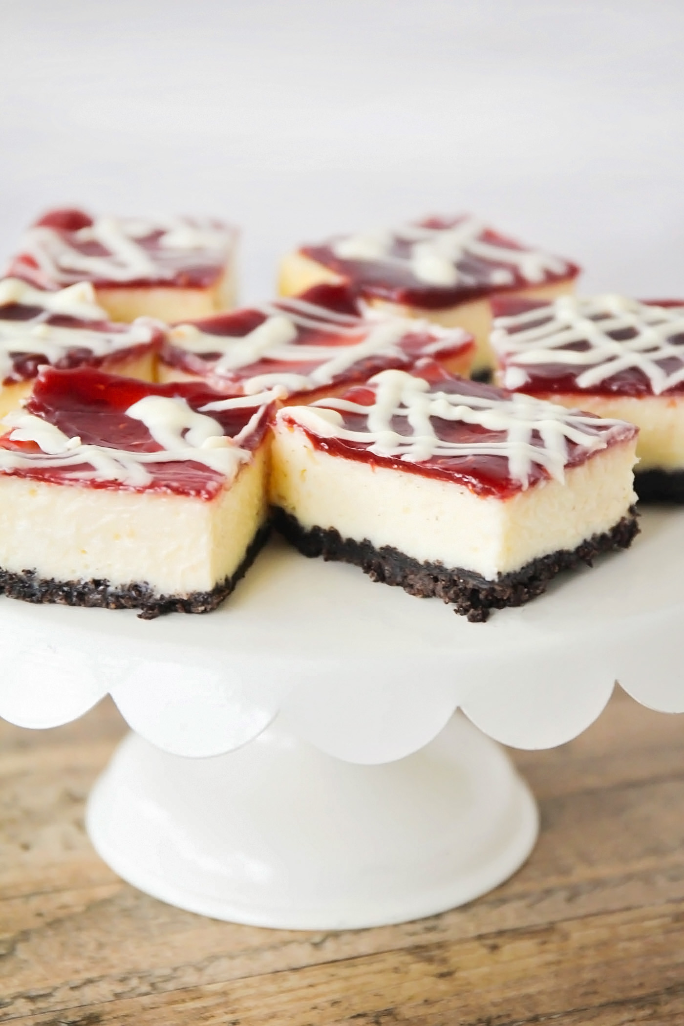 These White Chocolate Raspberry Cheesecake Bars may look fancy but they're easy to make! The rich flavors and homemade oreo crust make them hard to resist.