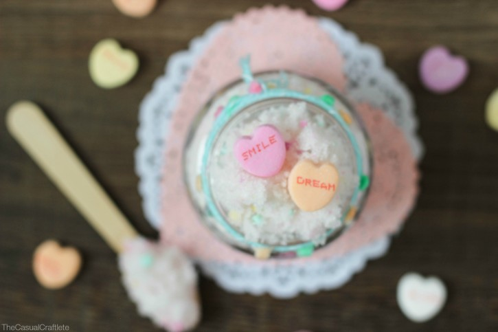 Looking for a fun, handmade gift to give this Valentine's Day? This DIY Conversation Hearts Sugar Scrub is so easy to make, smells delicious and is great for dry skin!